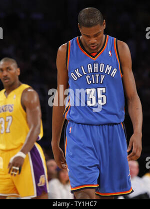 Oklahoma City Thunder forward Kevin Durant is dejected as Los Angeles Lakers' Ron Artest, left, watches at the end of the first half of Game 5 of their Western Conference playoff series at Staples Center in Los Angeles on April 27, 2010. The Lakers won 111-87. UPI Photo/Lori Shepler