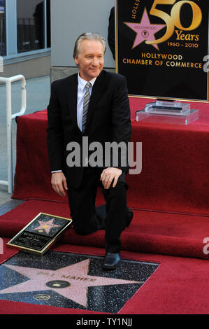 Comedian and television host Bill Maher kneels next to his star during an unveiling ceremony honoring him with the 2,417th star on the Hollywood Walk of Fame in Los Angeles on September 14, 2010.     UPI/Jim Ruymen - Stock Photo