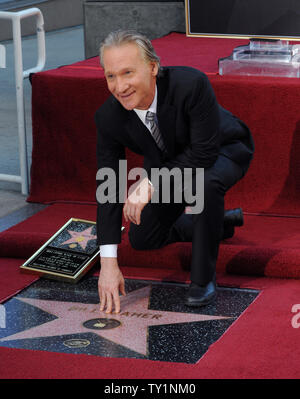 Comedian and television host Bill Maher kneels next to his star during an unveiling ceremony honoring heim with the 2,417th star on the Hollywood Walk of Fame in Los Angeles on Setember 14, 2010.     UPI/Jim Ruymen - Stock Photo