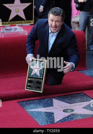 Actor Alec Baldwin holds a replica plaques as gestures during an unveiling ceremony honoring him with the 2,433rd star on the Hollywood Walk of Fame in Los Angeles on February 14, 2011.  UPI/Jim Ruymen - Stock Photo