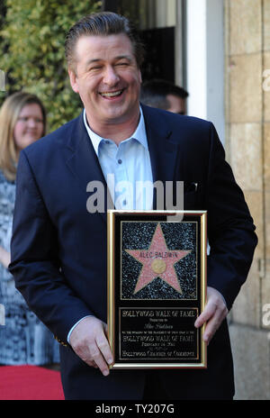 Actor Alec Baldwin holds a replica plaques as he savors the moment during an unveiling ceremony honoring him with the 2,433rd star on the Hollywood Walk of Fame in Los Angeles on February 14, 2011.  UPI/Jim Ruymen - Stock Photo