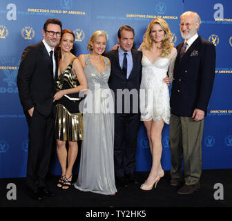 Michel Hazanavicius (L), director of 'The Artist', celebrates backstage with his award for outstanding directorial achievement in feature film with cast members Berenice Bejo, Penelope Ann Miller, Jean Dujardin, Missi Pyle and James Cromwell (L-R) at the 64th annual Directors Guild of America Awards in Los Angeles on January 28, 2012.   UPI/Jim Ruymen - Stock Photo