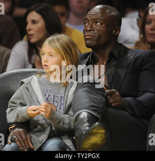 Seal sits with his daughter , Leni, during NBA basketball game with the Los Angeles Lakers and the Boston Celtics in Los Angeles on March 11, 2012.  The Lakers won 97-94. UPI/Lori Shepler - Stock Photo