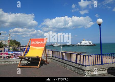 Deckchair on Eastbourne Promenade, East Sussex, UK - Stock Photo