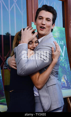 Actors Shailene Woodley and Miles Teller (R), cast members in the motion picture dramatic comedy 'The Spectacular Now', attend the premiere of the film at the historic Vista Theatre in the East Hollywood area of Los Angeles on July 30, 2013. In the film, a hard-partying high school senior's philosophy on life changes when he meets the not-so-typical 'nice girl,' who reads science fiction and doesn't have a boyfriend. While Amy has dreams of a future, Sutter lives in the impressive delusion of a spectacular now, yet somehow, they're drawn together.  UPI/Jim Ruymen - Stock Photo