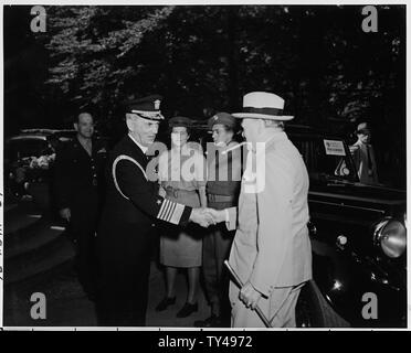 Fleet Admiral William Leahy greets Prime Minister Winston Churchill at the entrance to the Little White House (President Truman's residence during the Potsdam Conference) as the Prime Minister calls on the President for the first time. In the background are Gen. Harry Vaughan, Mary Churchill, the daughter of Winston Churchill, and Prime Minister Churchill's bodyguard. - Stock Photo