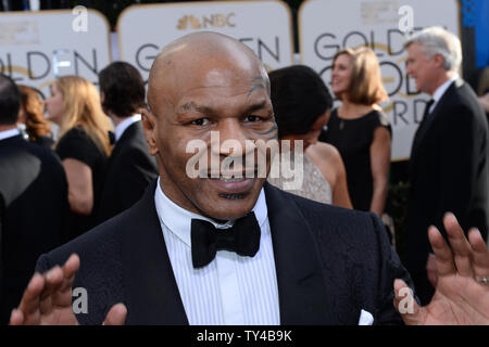 Former heavyweight boxing champion Mike Tyson arrives for the 71st annual Golden Globe Awards at the Beverly Hilton Hotel in Beverly Hills, California on January 12, 2014. UPI/Jim Ruymen - Stock Photo