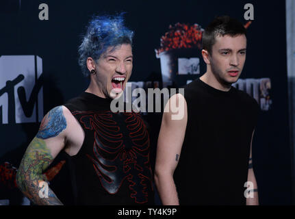 Musicians Josh Dun and Tyler Joseph of Twenty One Pilots appear backstage at The MTV Movie Awards at Nokia Theatre L.A. Live in Los Angeles, California on April 13, 2014.  UPI/Jim Ruymen - Stock Photo