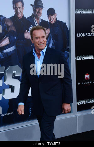 Actor Arnold Schwarzenegger attends the premiere of the motion picture thriller 'The Expendables 3' at TCL Chinese Theatre in the Hollywood section of Los Angeles on August 11, 2014. Storyline: Barney (Sylvester Stallone) augments his team with new blood for a personal battle: to take down Conrad Stonebanks, the Expendables co-founder and notorious arms trader who is hell bent on wiping out Barney and every single one of his associates.  UPI/Jim Ruymen - Stock Photo