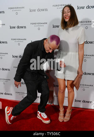 Cast member Flea and actress Sandha Khin attends the premiere of the biographical motion picture drama 'Low Down' at the Arclight Cinerama Dome in the Hollywood section of Los Angeles on October 23, 2014. Storyline:  A look at the life of pianist Joe Albany from the perspective of his young daughter, as she watches him contend with his drug addiction during the 1960s and '70s jazz scene.  UPI/Jim Ruymen - Stock Photo