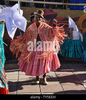 Cholita dancing in El Alto, La Paz, Bolivia - Stock Photo