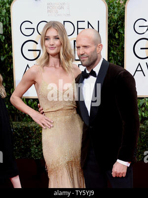 Model Rosie Huntington-Whitely, left, and actor Jason Statham attend the 73rd annual Golden Globe Awards at the Beverly Hilton Hotel in Beverly Hills, California on January 10, 2016. Photo by Jim Ruymen/UPI - Stock Photo
