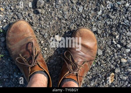 male feet in brown leather shoes top view - Stock Photo