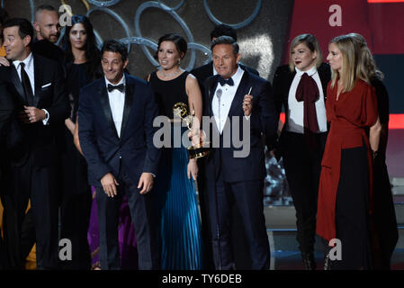 Producer Mark Burnett (C) and cast and crew of 'The Voice