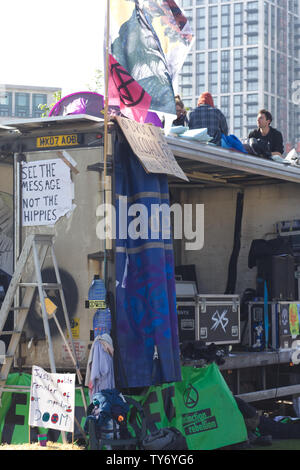 see the message, not the hippies, truck  extinction rebellion protest in London - Stock Photo