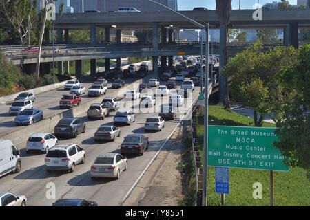 Traffic builds north and south on the 110 Freeway in