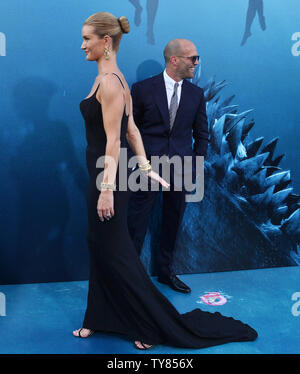 Cast member Jason Statham and his partner, English actress and model Rosie Huntington-Whiteley attend the premiere of the sci-fi motion picture thriller 'The Meg' at TCL Chinese Theatre in the Hollywood section of Los Angeles on August 6, 2018. Storyline: After escaping an attack by what he claims was a 70-foot shark, Jonas Taylor must confront his fears to save those trapped in a sunken submersible.   Photo by Jim Ruymen/UPI - Stock Photo