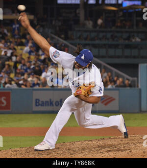 Los Angeles Dodgers' closing pitcher Kenley Jansen delivers in the ninth inning against the Arizona Diamondbacks at Dodger Stadium in Los Angeles on August 31, 2018. It was JansenÕs first appearance without allowing a run since before he landed on the disabled list on Aug. 10 with issues related to his irregular heartbeat. The Dodgers won 3-2.  Photo by Jim Ruymen/UPI - Stock Photo