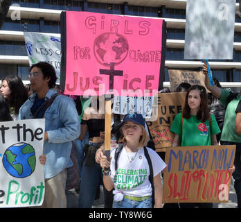 Several hundred students and environmental activists converged on City Hall and marched to the Department of Water and Power to take part in a worldwide school walkout to call for more aggressive action on fighting climate change, with a national embrace of the Green New Deal, an end to fossil fuel infrastructure projects and a number of other aggressive actions on climate change. Protests are also occurred in at least several dozen other California cities, Chicago, New York, Washington D.C., dozens of European capitals, New Zealand, India and elsewhere.  Photo by Jim Ruymen/UPI - Stock Photo