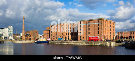 View across the Canning Half-Tide Dock, to Liverpool's Maritime Museum  and the Royal Albert Dock beyond. - Stock Photo