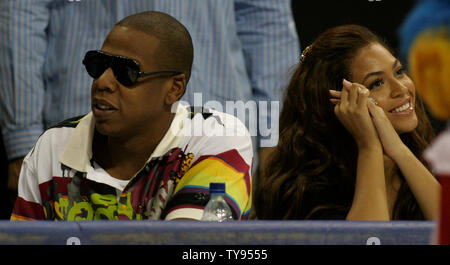 Music icon Beyonce and rapper Jay-Z enjoy the U.S.A. Olympic Basketball teams 118-79 victory over Uruguay from court-side seats at the Thomas & Mack Center in Las Vegas, Nevada on August 29, 2007. (UPI Photo/Daniel Gluskoter) - Stock Photo