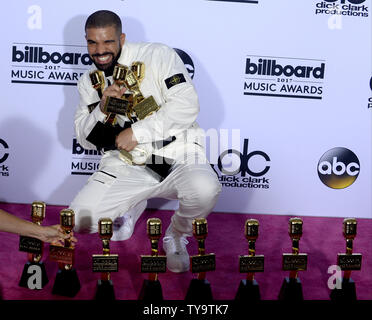 Recording artist Drake appears backstage with his awards for