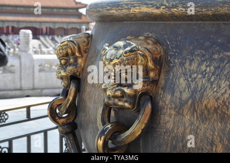 Beijing Imperial Palace gods and beasts, copper lions, large copper cylinders - Stock Photo