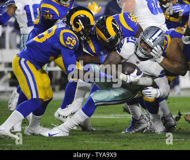 Dallas Cowboys running back Ezekiel Elliott is stopped by the Los Angeles Rams in the first half of their divisional-round playoff game at The Coliseum in Los Angeles, California on January 12, 2019. Photo by Lori Shepler/UPI - Stock Photo
