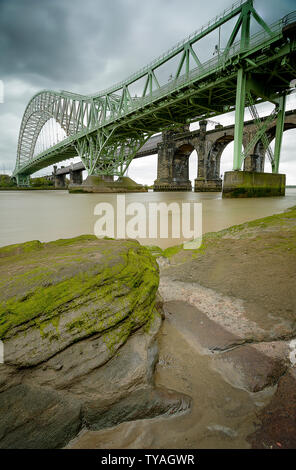 Low Level View of the Original Mesey Crossing at Runcorn, from West Bank - Stock Photo
