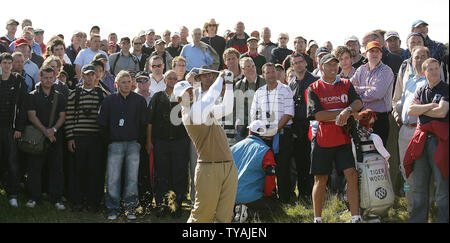 American Tiger Woods hits out off the rough on the 10th hole on the second day at the 136th Open Championship at Carnoustie, Scotland on July 20, 2007.(UPI Photo/Hugo Philpott) - Stock Photo