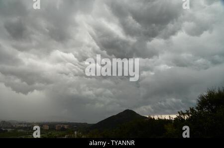 Rainy cloudscape over Mountain San Peyre in Mandelieu-La Napoule, France - Stock Photo