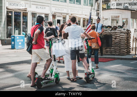 Berlin, Germany - June, 2019: Tourist group riding Electric scooter , escooter or e-scooter on street  in Berlin, Germany - Stock Photo