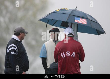 Team USA's Tiger Woods shelters from the rain on the fourth hole of the first day of the 2010 Ryder Cup at Celtic Manor resort in Newport, Wales on October 01 2010.    UPI/Hugo Philpott - Stock Photo