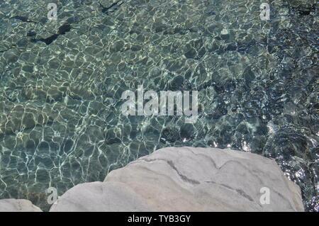 Crystal clear ocean of Karpathos, a small greece island in the aegean sea. - Stock Photo