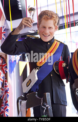 An actor wearing a mask and dressed as Prince Harry performs in a window of a Selfridges department store in London on April 28, 2011.  Visitors from around the world are expected to arrive in London this week for the royal wedding of HRH Prince William and Kate Middleton, which will take place on April 29, 2011.   UPI/ David Silpa - Stock Photo