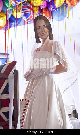An actor wearing a mask and dressed as Kate Middleton performs in a window of a Selfridges department store in London on April 28, 2011.  Visitors from around the world are expected to arrive in London this week for the royal wedding of HRH Prince William and Kate Middleton, which will take place on April 29, 2011.   UPI/ David Silpa - Stock Photo