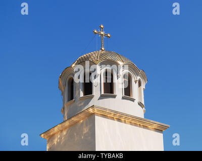 Golden Cross On Church Roof Top With A Blue Sky Stock