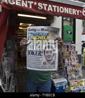 The London Daily Mail from page is held by a paper vendor on the streets of London on July 21, 2012. Most of the papers in London front paged James Holmes who is the suspect in a movie theater shooting spree that left 12 people dead, in Aurora, Colorado.  UPI/Terry Schmitt - Stock Photo