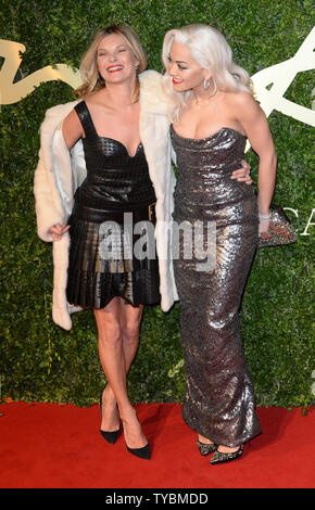 British model Kate Moss and singer Rita Ora attend the 'British Fashion Awards' at The Coliseum in London on December 2, 2013.     UPI/ Rune Hellestad - Stock Photo