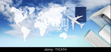 booking and search flight ticket air travel vacation concept, passport, computer and airplane on sky background with global map - Stock Photo