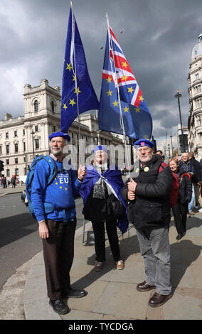 Brexit protestors campaign outside the Houses of Parliament in London, April 03, 2019. Theresa May is due to have talks with the Leader of the opposition Jeremy Corbyn to give her a chance of securing a Brexit deal before April 12th or the United Kingdom will crash out of the European Union without a deal.            Photo by Hugo Philpott/UPI - Stock Photo