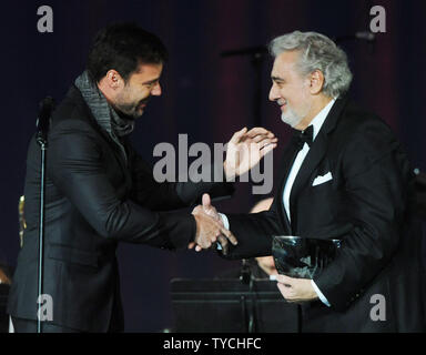 Ricky Martin (L) presents Placido Domingo with the Latin Recording Academy Person of the Year Award, at the Mandalay Bay in Las Vegas, Nevada on November 10, 2010.  UPI/Jim Ruymen - Stock Photo