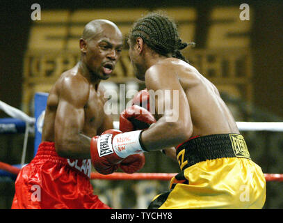 Featherweight titilist Michael Clark (left) won a 12 round decision to retain his title at Orleans Hotel and Casino in Las Vegas Nevada, October 18, 2003.  (UPI/Roger Williams) - Stock Photo