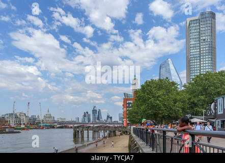 Panoramic view of South Bank Tower, Oxo Tower Wharf, Blackfriars Bridge and iconic City of London skyscrapers on the skyline over the River Thames - Stock Photo