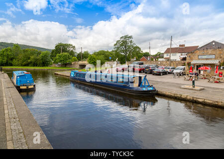 Colourful holiday narrowboats in Trevor Basin on the Llangollen Canal, Clwyd, Wales, UK - Stock Photo