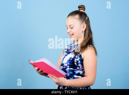 publishing house. chef editor look throught article. little publisher. school newspaper reporter. small girl with note book. child with notepad. workbook for writing. school diaries for making notes. - Stock Photo