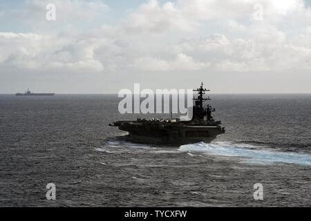 PACIFIC OCEAN (Oct. 31, 2016) The aircraft carriers USS Carl Vinson (CVN 70) and USS Nimitz (CVN 68) transit the Pacific Ocean. Carl Vinson is underway conducting Composite Training Unit Exercise (COMPTUEX) off the coast of Southern California. - Stock Photo