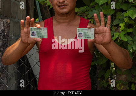 Brayan Rosales Hidalgo from Honduras  holds his and his son's Antony's (INM) Instituto Nacional de Migración regional visitor visa cards near a sports complex, a makeshift detention center in Mapastepec, Mexico on May 7, 2019. The regional visas that Rosales has is only good for four Southern Mexican states, Tabasco, Chiapas, Campeche and Quintana Roo.    Photo by Ariana Drehsler/UPI - Stock Photo