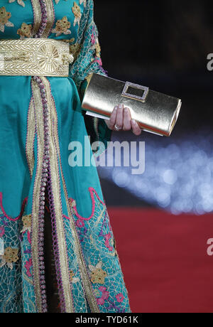 A Moroccan dress is seen on a guest arriving on the red carpet during the Marrakech International Film Festival in Marrakech on December 6, 2009.   UPI/David Silpa - Stock Photo