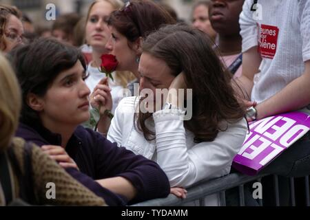Supporters of Segolene Royal, socialist candidate in France's presidential elections, react after the announcement of the elections results in Paris, May 6, 2007. Royal lost to conservative Nicolas Sarkozy. (UPI Photo/Khanh Renaud) - Stock Photo
